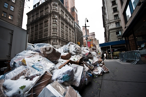 Piles of Trash left on the walkway in New York